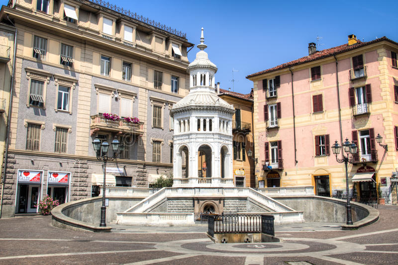 Square with fountain in Acqui Terme, Italy. ACQUI TERME, ITALY - JULY 2016: The main square with fountain in Acqui Terme, Italy royalty free stock image