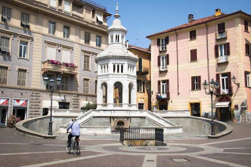 Square with fountain in Acqui Terme, Italy. ACQUI TERME, ITALY - JULY 2016: The main square with fountain in Acqui Terme, Italy stock photography