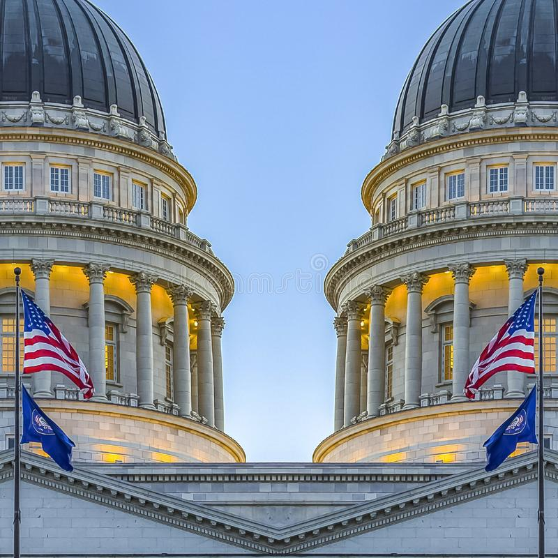 Square frame Dual Capital building with the flags pointed in stock photo