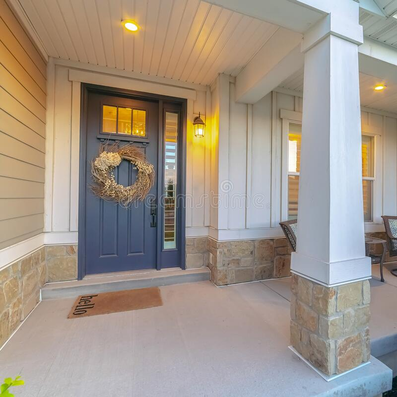 Free Square Front And Sidelight Of Home With Front Porch And Wood Siding Exetrior Wall Stock Images - 168773854