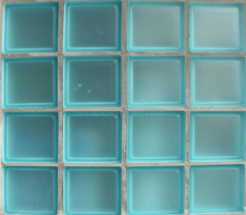Square glass tiles from window in bright blue stock photo Bright blue tile