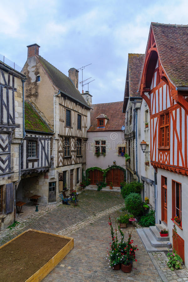 Square with half-timbered houses, in the medieval village Noyers-sur-Serein. Sunrise view of a square place de la petite etape aux vins, with half-timbered royalty free stock photo