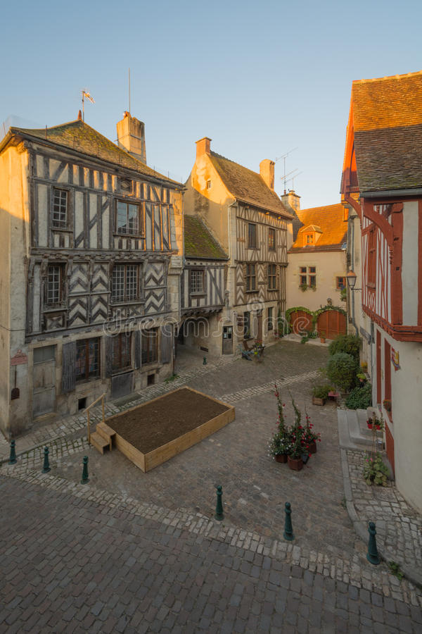 Square with half-timbered houses, in the medieval village Noyers-sur-Serein. View of a square & x28;place de la petite etape aux vins& x29;, with half-timbered stock photos