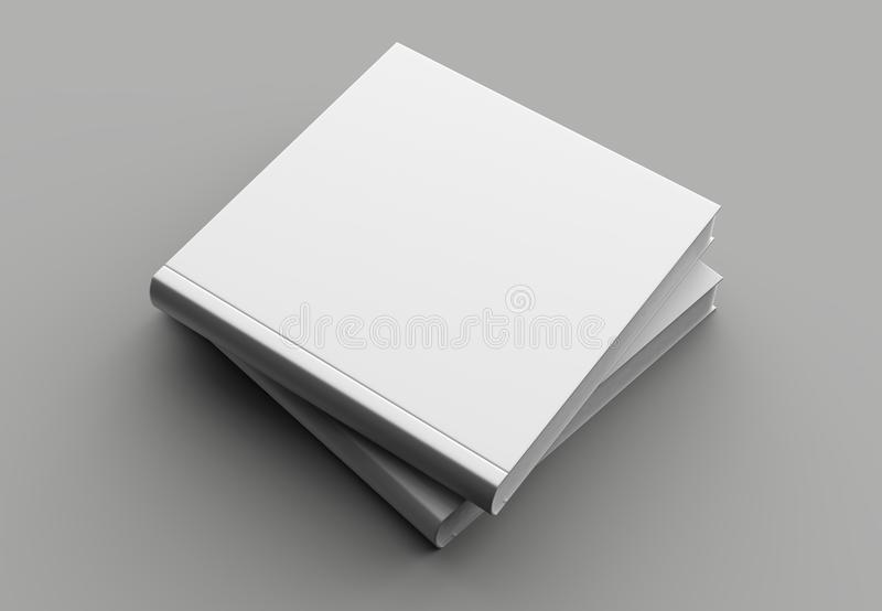 Square hard cover book mock up isolated on soft gray background. royalty free stock photos