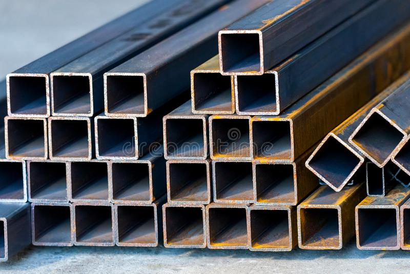 Square high carbon metal tube background for heavy industry stock photos