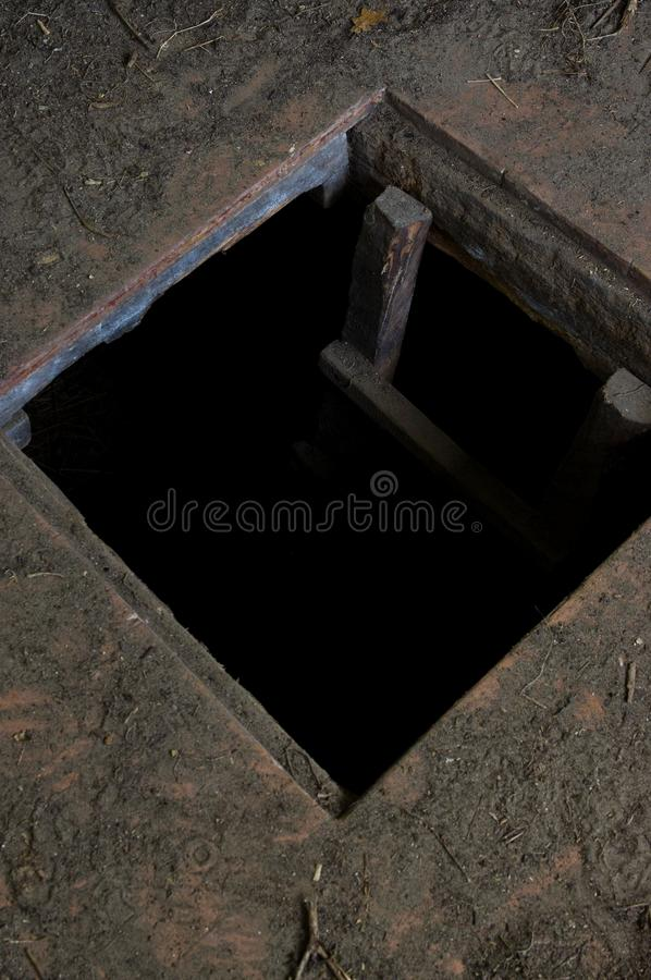 Hole in floor of old house leading to cellar stock images
