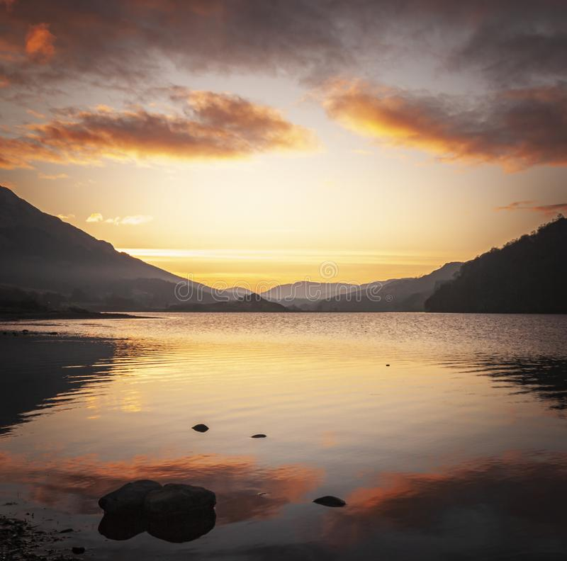 Square Loch Lubhair. A square image of the winter sun setting over Loch Lubhair, Perthshire, Scotland royalty free stock photography