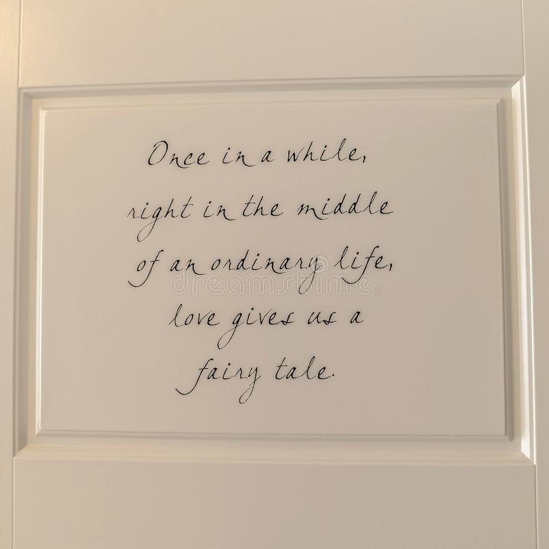 square inspirational quote on the back of home door stock image
