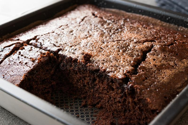 Square Juicy Chocolate Sponge Wet Cake with Sauce in Mold. royalty free stock images