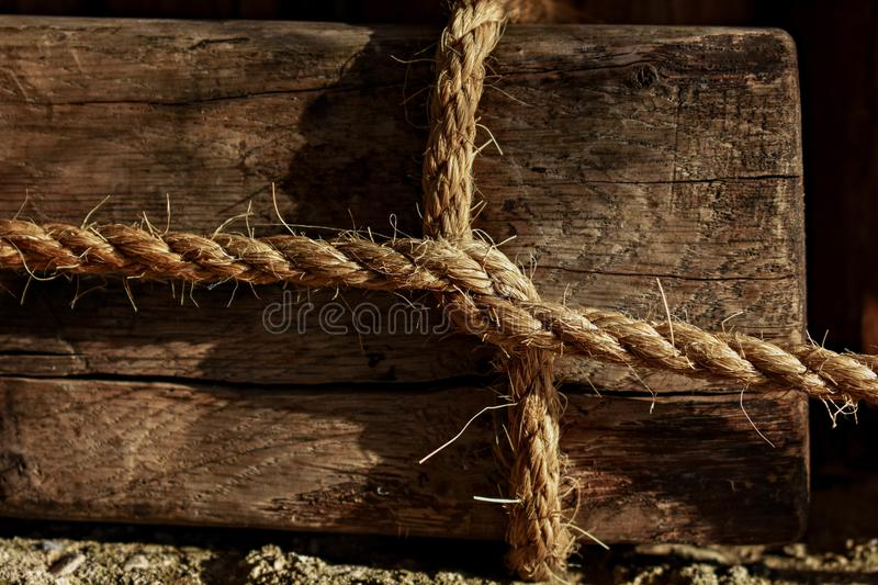 Square Knot whit white rope. Closeup abstract wooden background whit old rope T still life photography royalty free stock image