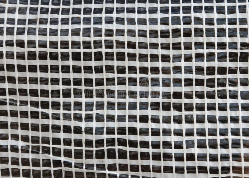 Square mesh texture. White square mesh texture close up stock photography