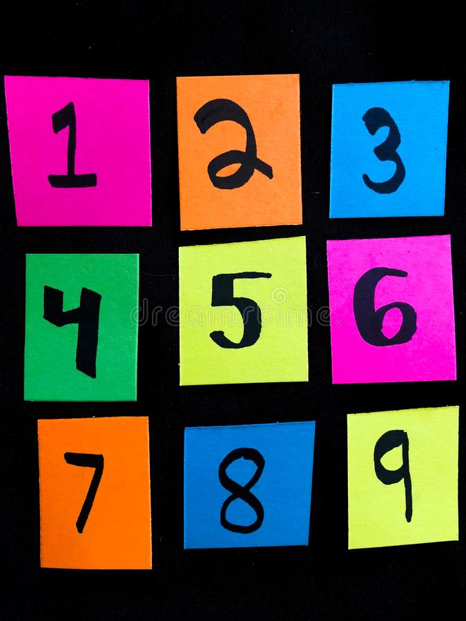 Colorful Neon Number Key Pad on Black Background stock image