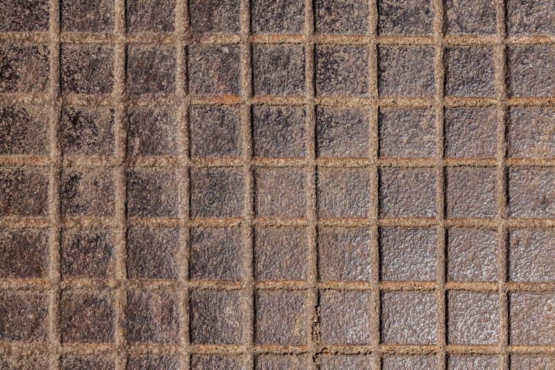 Square notches cast iron background stock images