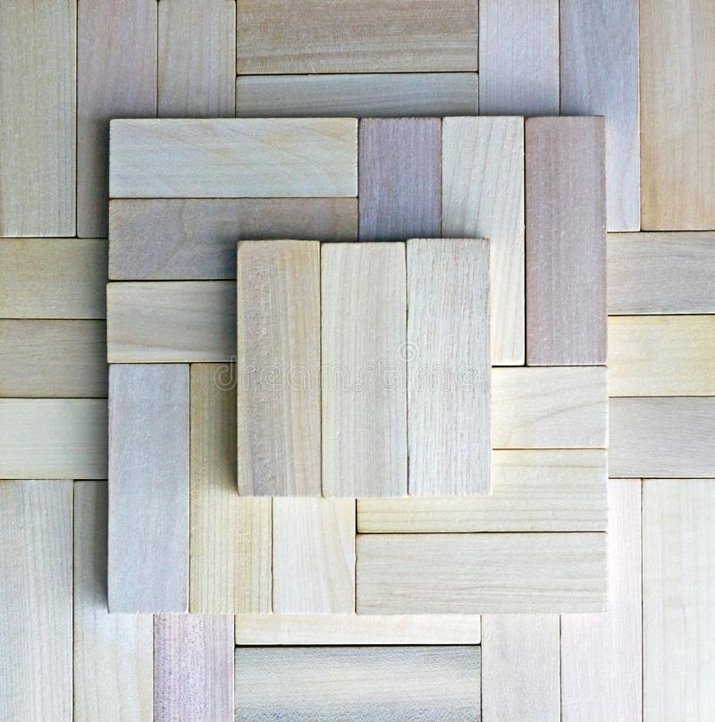 Square pattern built with wooden blocks royalty free stock photo
