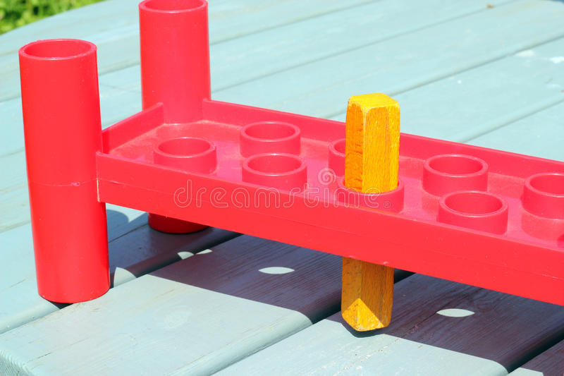 A square peg in a round hole. stock photos
