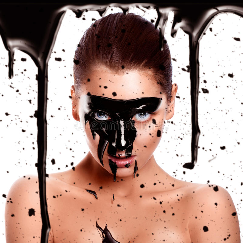 Square photo of woman with paint on face. In studio royalty free stock photo
