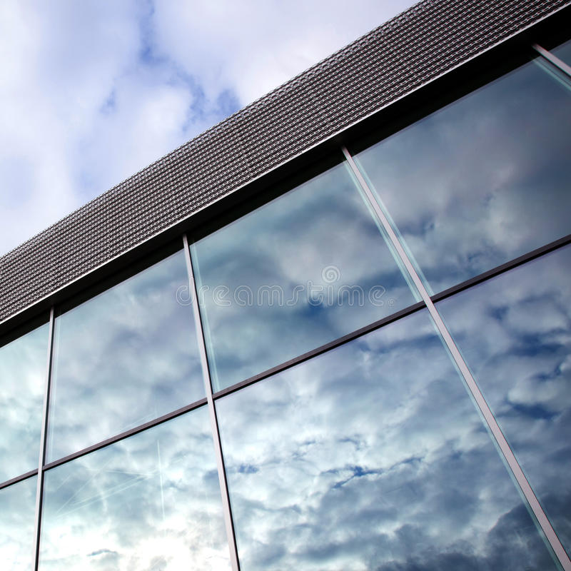 Download Clouds Reflected In Windows Of Office Building Royalty Free Stock Images - Image: 30102169