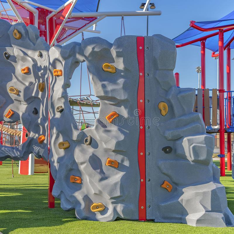 Square Playground equipment at a park under blue sky on a sunny day stock photos