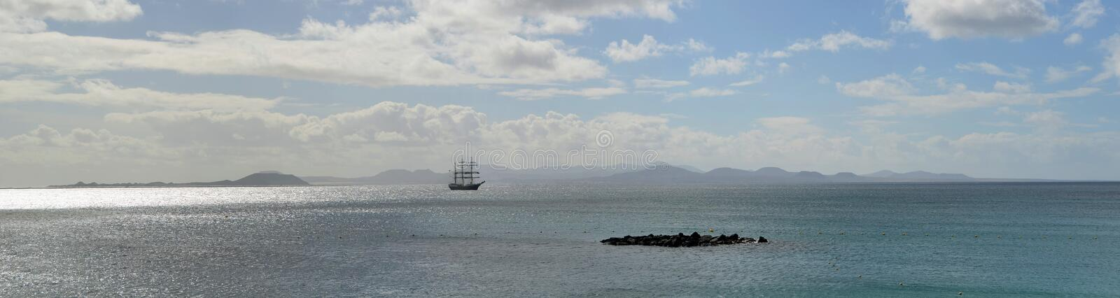 Square Rigged Tall Ship with the Northern Coast of Fuerteventura royalty free stock images