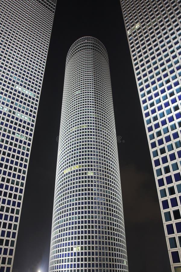 square runda skyskrapor för natt trekantigt royaltyfri fotografi