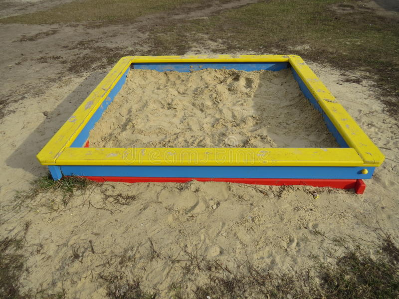 Square sandpit. Small square sandpit in the playground outside stock photo