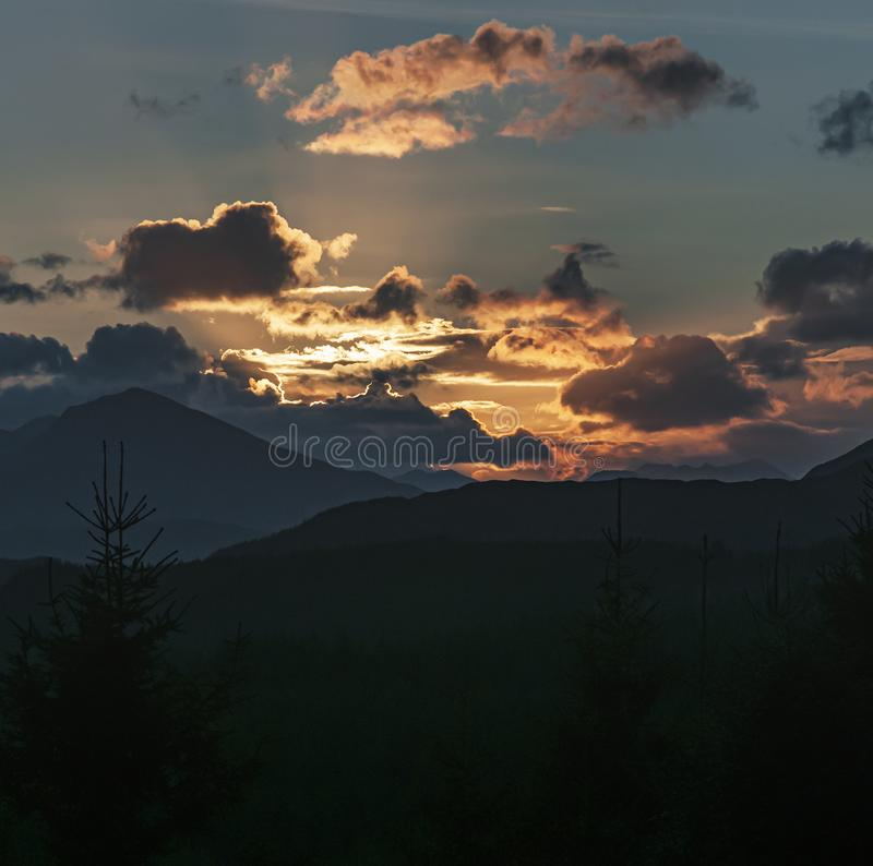 Square Scottish sunset. An autumnal square format sunset from the A87 viewpoint looking down Glen Garry, lochaber, Scotland royalty free stock photography