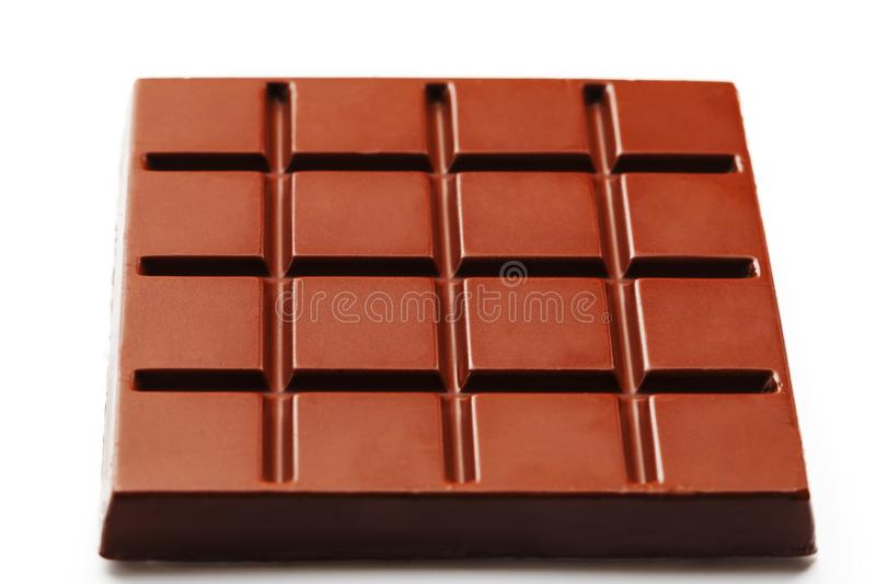Square-shaped milk chocolate on a white background from above. Isolated A whole plate of dark chocolate isolated on white from stock photos