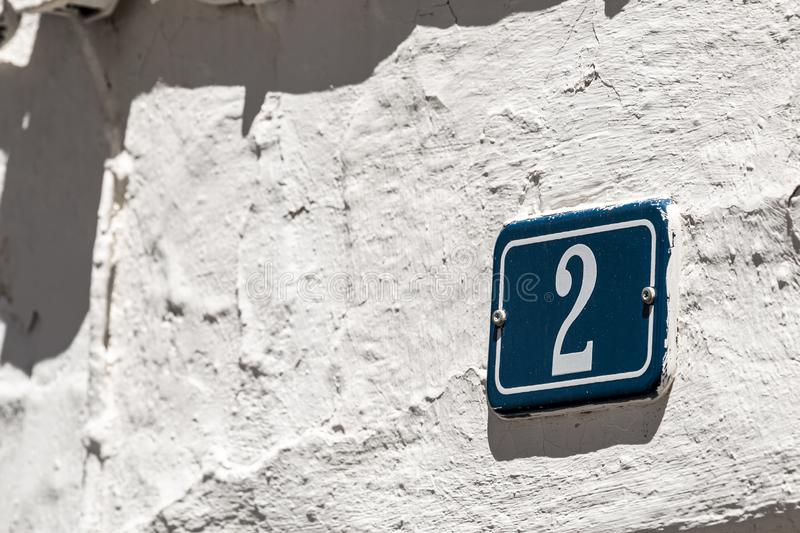 Number sign on plaster wall stock photos