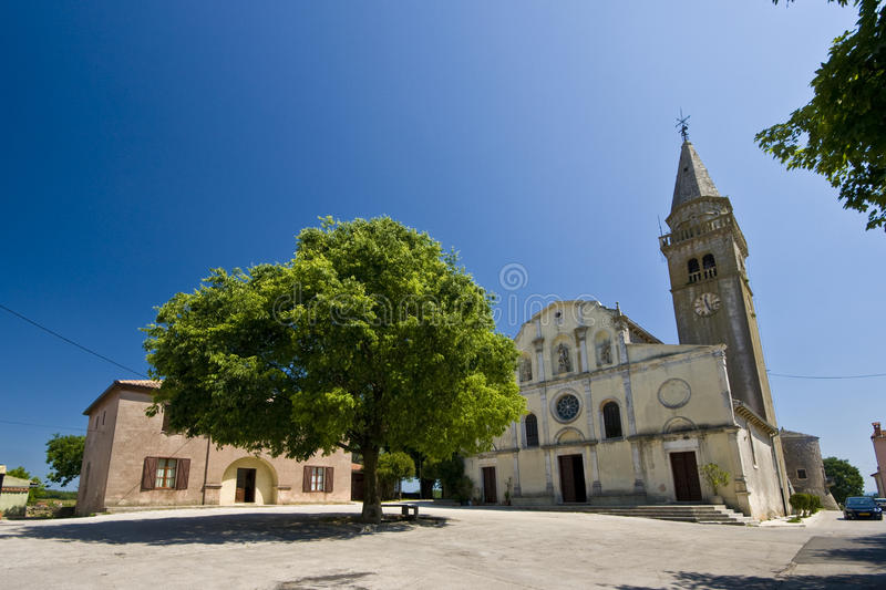 The square and St. Michael`s church in Zminj royalty free stock photo