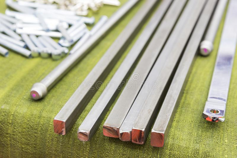 Square steel rod for manufacturing parts. Close up, metal, bar, iron, profile, warehouse, storage, products, background, group, construction, engineering stock photography