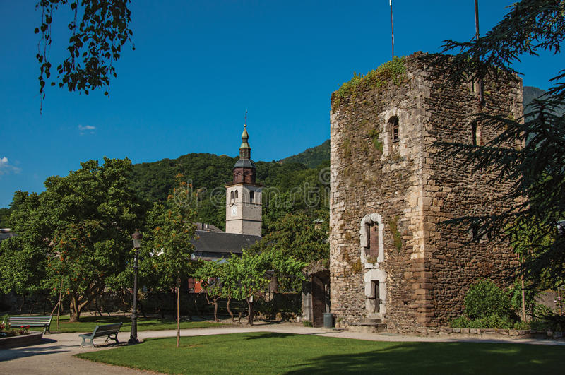 Square, stone building and flowery garden in city center of Conflans stock photography