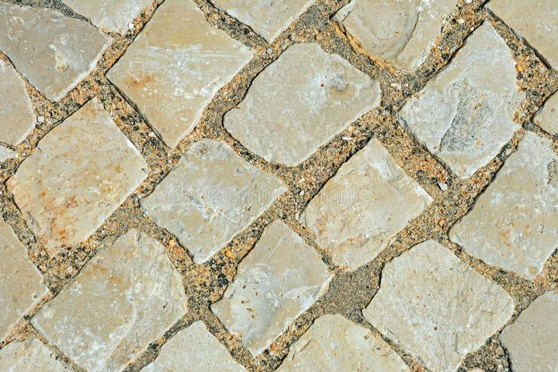 Pavement cobbles background. stock images