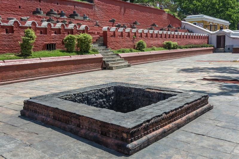 Square stone pit, covered in black soot, Pashupatinath Temple, N. Square stone pit covered with a black soot in the complex Pashupatinath Temple, Nepal royalty free stock images