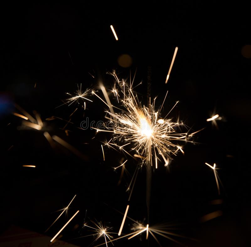 Square texture background Bengal fire sparkles. Against the background black stock photo
