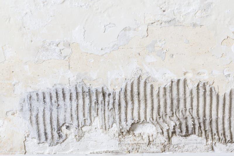 Square tile glue plaster wallpaper background texture. Square tile old glue plaster wallpaper background texture stock photo