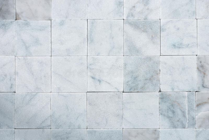 Square Tiles of White Carrara Marble royalty free stock photography