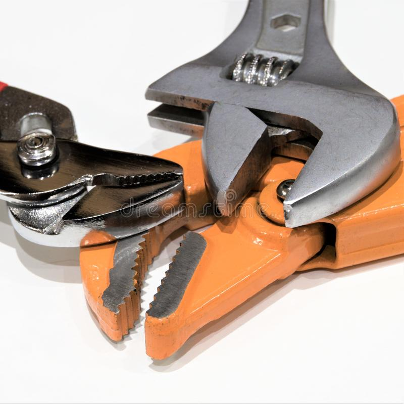 Square version of a set of three adjustable wrenches. royalty free stock images