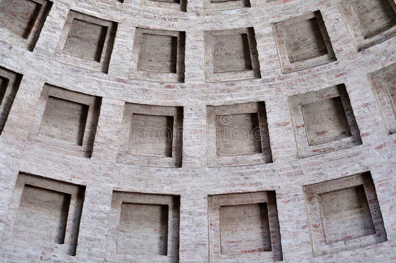 Square wall niches in a brick wall. Square wall niches in a dome structure of a neoclassical building royalty free stock photo