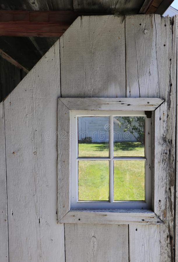 Square window in rustic barn door royalty free stock images