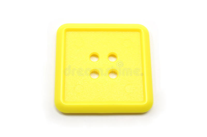 Download A square yellow button stock image. Image of holes, clothing - 14254891
