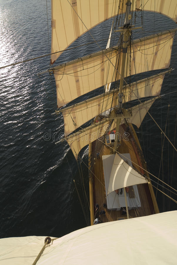 Squarerigger from aloft. The rigging of a squaresailer seen from aloft. Swedish tall ship, the brig Tre kronor af Stockholm underway during trial sails in royalty free stock images