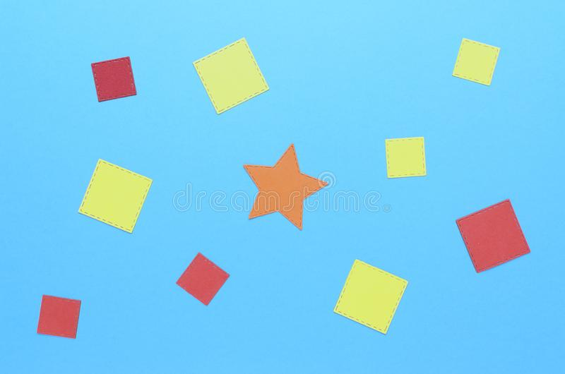 Squares of paper and an orange star in the center royalty free stock images