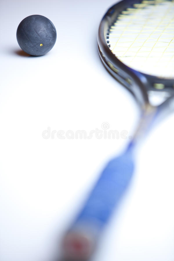 Squash ball and racket on white background royalty free stock photography