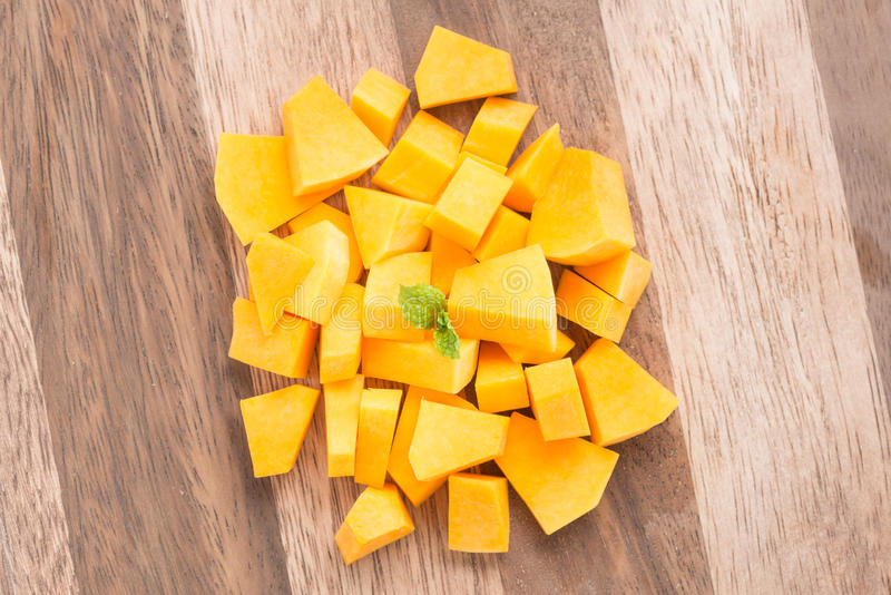 Squash butternut slice. Squash butternut slice on a wood background stock photography