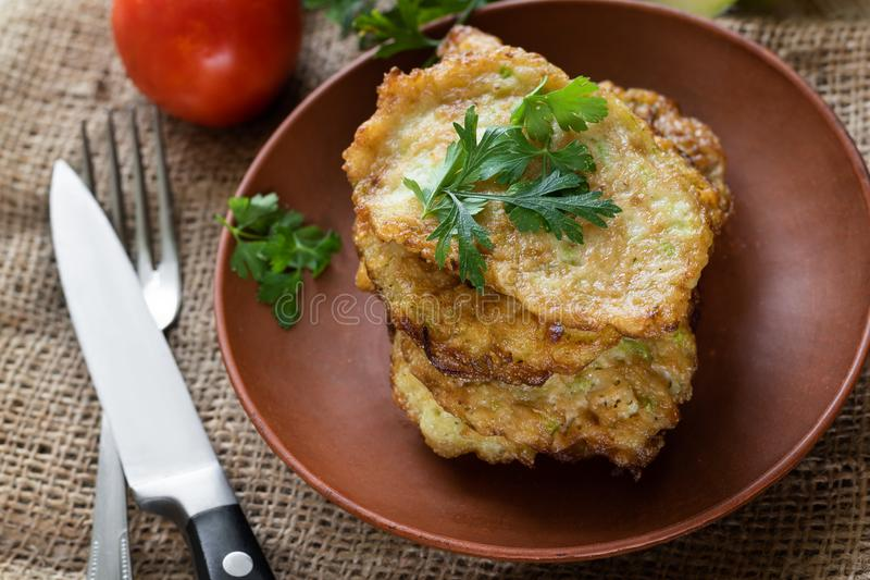 Squash fried fritters. Vegetable pancake, vegetarian food royalty free stock images