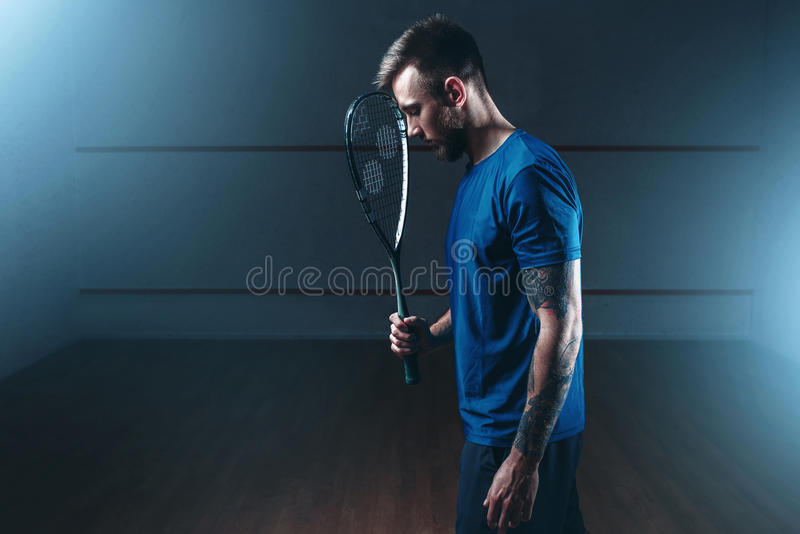 Squash game concept, male player with racket stock photos