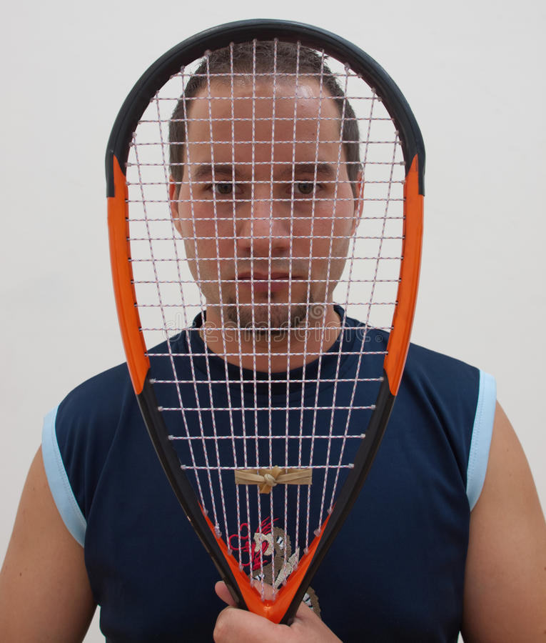 Squash player with racket stock photos
