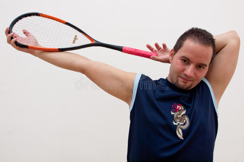 Squash player stretches royalty free stock photography
