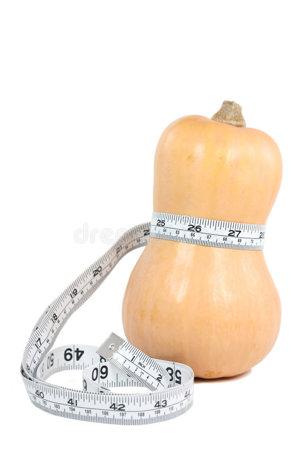 Squash That Waistline. A butternut squash's shape represents a slim waistline royalty free stock images