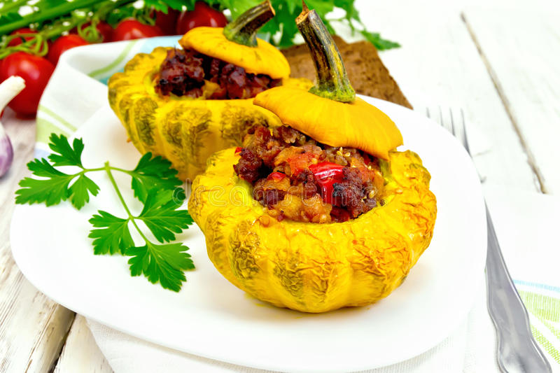 Squash yellow stuffed in white plate on board stock photos